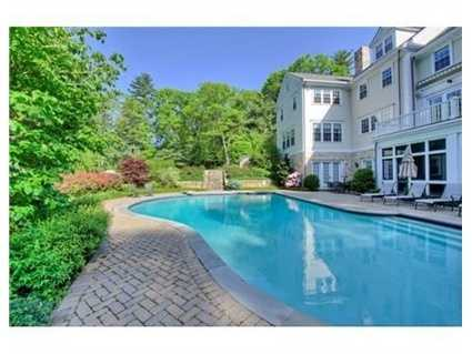 A gorgeous pool completes the yard.