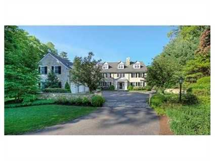 The home is a 2001 South Bay Quarzite Stone front colonial.