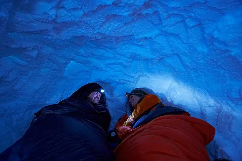 Snow is an excellent insulator. Even though snow is cold, it will keep you relatively warm as it will trap the heat from your body in the snow shelter.