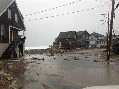 Debris in a coastal road in Scituate