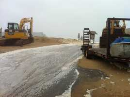 A little water has come up and over the barrier on Plum Island.