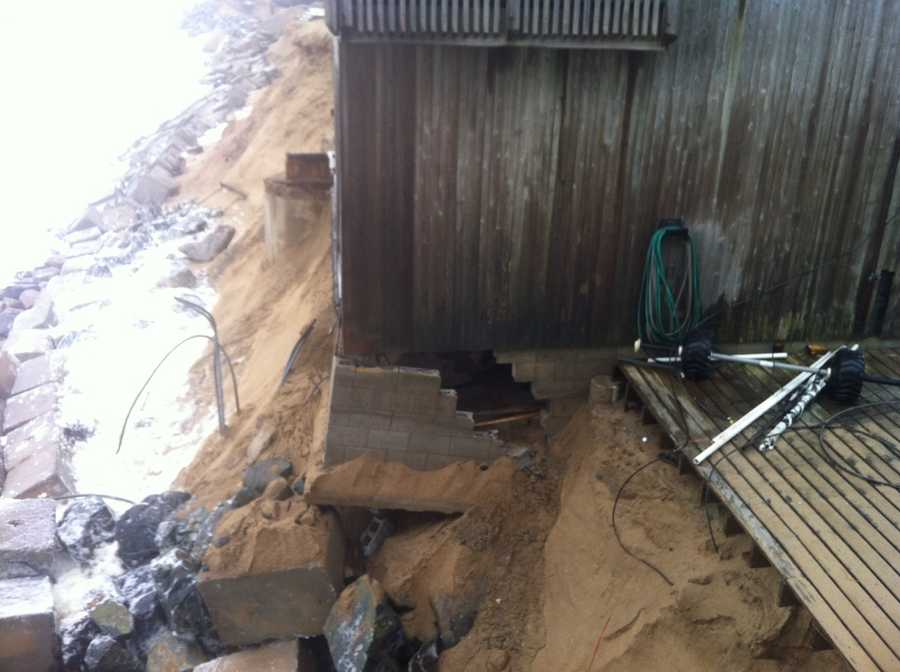 The foundation of this Plum Island home on Annapolis Way cracked, then gave way Thursday morning.
