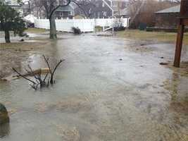 Flooded yards after high tide in Scituate