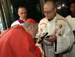 Oct. 1, 2006:O'Malley kisses the cross, the gesture which symbolizes the taking possession of his titular church, Santa Maria della Vittoria in Rome.