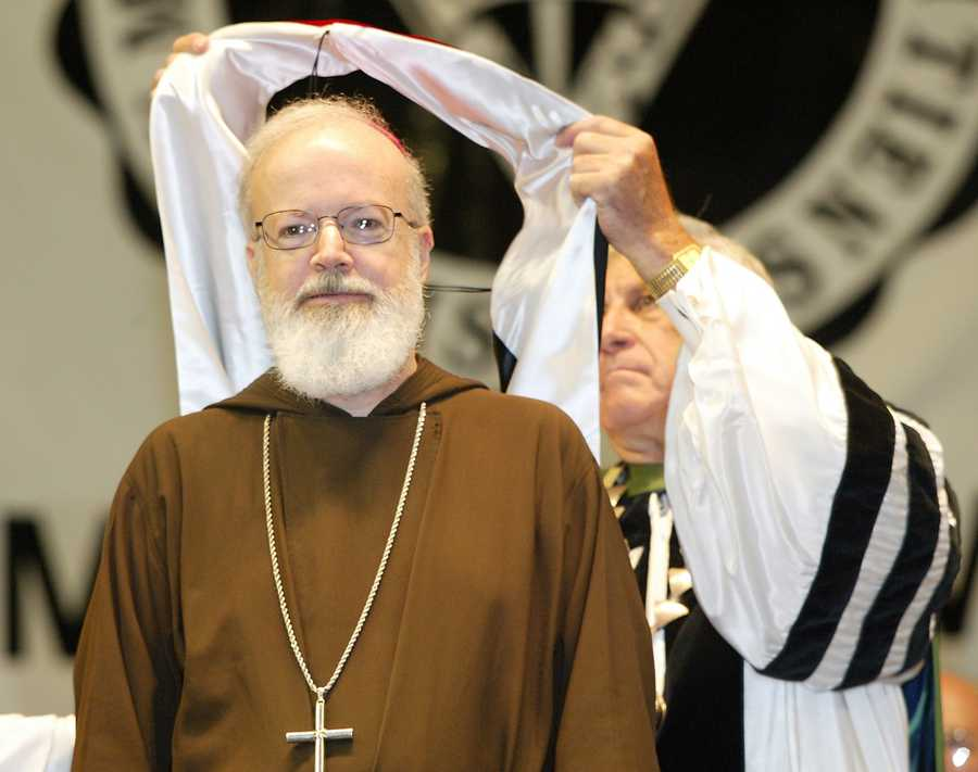 Sunday, May 16, 2004: The Rev. Philip Smith, right, president of Providence College, confers an honorary degree of Doctor of Divinity to Boston Archbishop Sean Patrick O'Malley.