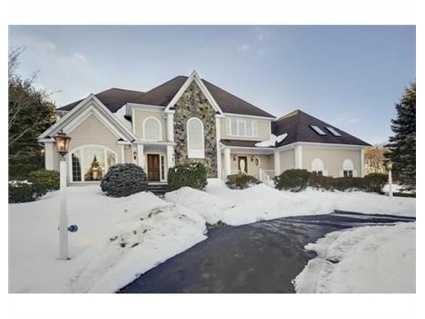 The stunning colonial sits on a prime lot.