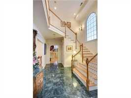A dramatic two-story open foyer.