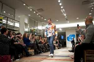 Rob getting the attention of the crowd as he models off spring fashion.