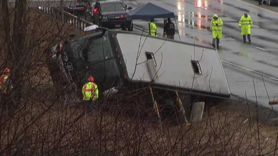 A car spun out of control on a wet highway in upstate New York, crashing into a bus carrying college lacrosse players from Vermont and sending it toppling it onto its side, authorities said.