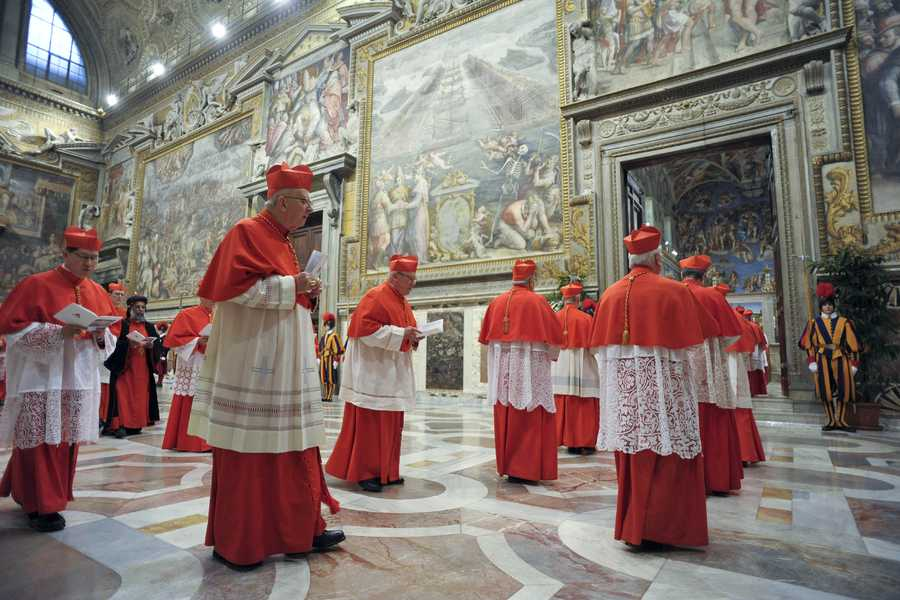 In this picture released by the Vatican newspaper L'Osservatore Romano, cardinals enter the Sistine Chapel prior to the start of the conclave, at the Vatican, Tuesday, March 12, 2013.