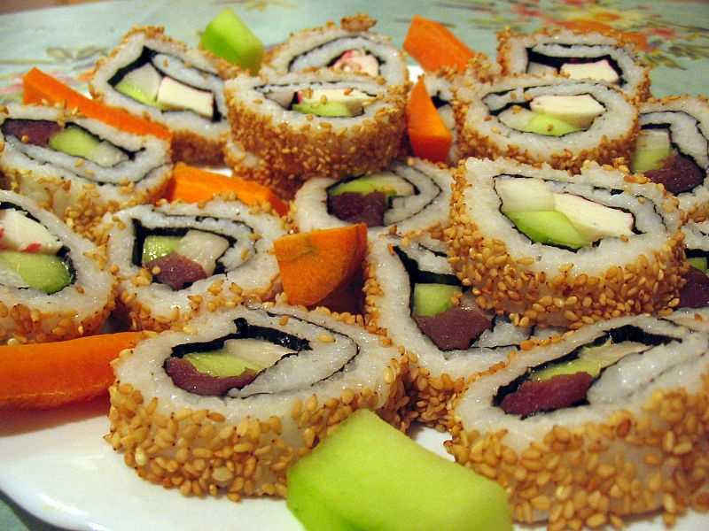 A California roll equals two sandwiches filled with crab sticks, a sliver of avocado and a tiny bit of vegetables.