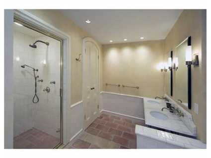There's a total of 4 bathrooms and 1 partial bath.