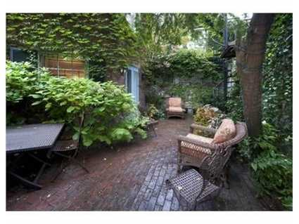 """Perhaps the most unique feature is the """"guest cottage"""" at the end of the walled garden."""