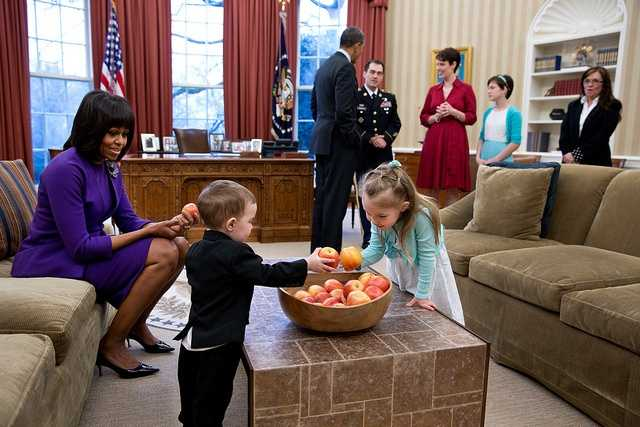 President Barack Obama and First Lady Michelle Obama visit with former Staff Sergeant Clinton Romesha and his family in the Oval Office prior to a ceremony to award Romesha the Medal of Honor, Feb. 11, 2013. Remesha's family members, from left, are: son Colin Romesha, 2&#x3B; daughter Gwen Romesha, 4&#x3B; wife Tammy Romesha, daughter Dessi Romesha, 11&#x3B; and mother Tish Rogers.