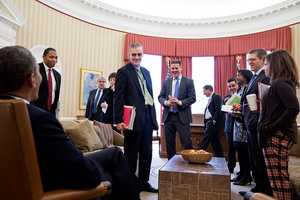 President Barack Obama talks with senior advisors following a meeting in the Oval Office, Feb. 27, 2013.