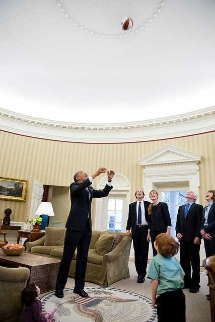 President Barack Obama throws a basketball in the air during departure photos with Samantha Power, Senior Director for Multilateral Affairs and Human Rights, and her family in the Oval Office, Feb. 22, 2013. Watching the President, from left, are: Rian Power-Sunstein, Cass Sunstein, Samatha Power, Declan Sunstein, James Bourke, and Veronica Delany.