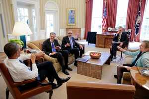 President Barack Obama meets with Solicitor General Donald Verrilli, left, and Attorney General Eric Holder in the Oval Office, Feb 21, 2013. Chief of Staff Denis McDonough and Kathryn Ruemmler, Counsel to the President, join them.