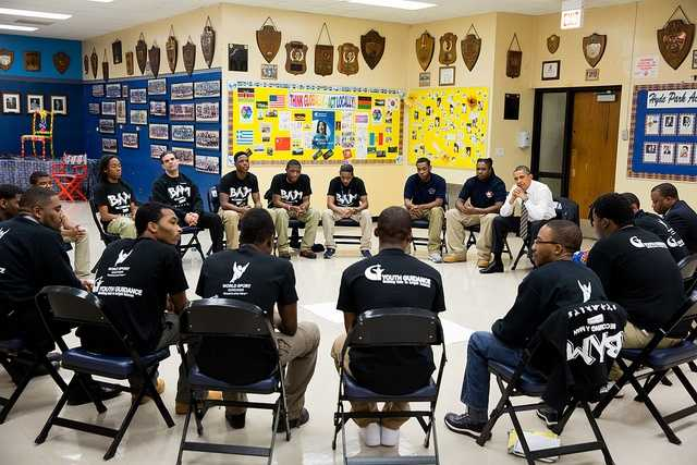 "President Barack Obama participates in a ""Becoming a Man"" program roundtable at the Hyde Park Career Academy in Chicago, Ill., Feb. 15, 2013."