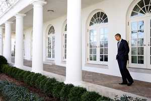 President Barack Obama walks on the Colonnade of the White House on his way to the Oval Office, Feb. 12, 2013