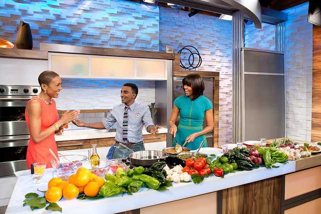 "First Lady Michelle Obama, ""Good Morning America"" anchor Robin Roberts, and chef Marcus Samuelsson participate in a cooking segment at the GMA Studios in New York, N.Y., Feb. 22, 2013."