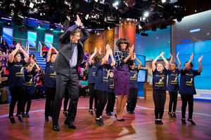 """First Lady Michelle Obama and Dr. Mehmet Oz learn a dance routine with members of the Terence C. Reilly School No. 7 dance group during a taping of the """"Dr. Oz Show"""" at the 30 Rock Studios in New York, N.Y., Feb. 22, 2013."""
