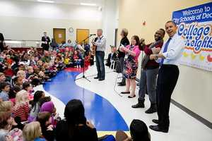 President Barack Obama joins in a music program at the College Heights Early Childhood Learning Center in Decatur, Ga., Feb. 14, 2013.