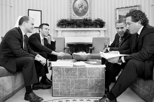 President Barack Obama works on his State of the Union address with staff in the Oval Office, Feb. 12, 2013. Seated, from left, are: Ben Rhodes, Deputy National Security Advisor for Strategic Communications&#x3B; Director of Speechwriting Jon Favreau&#x3B; and Cody Keenan, Deputy Director of Speechwriting.
