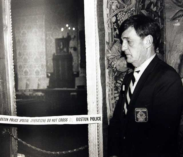 A security guard stands outside the Dutch Room of the Isabella Stewart Gardner Museum, the site where robbers stole treasured art objects in an early morning robbery, in this March 21, 1990 photo.