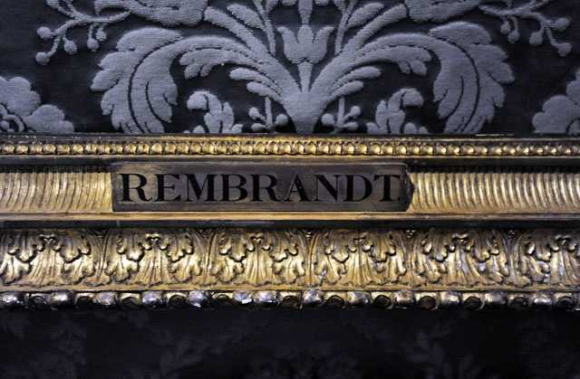 "In this Thursday, March 11, 2010 photo, a plaque marks the empty frame from which thieves cut Rembrandt's ""The storm on the Sea of Galilee,"" which remains on display at the Isabella Stewart Gardner Museum in Boston."
