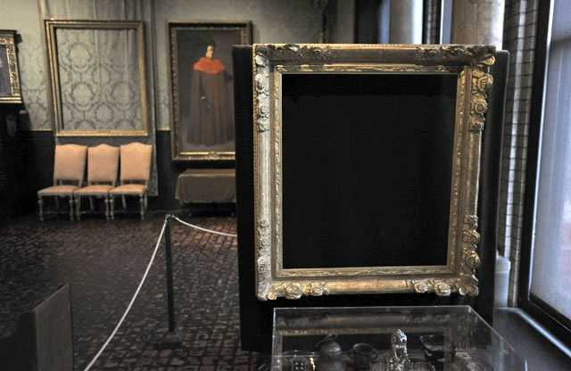 "In this Thursday, March 11, 2010 photo, empty frames from which thieves took ""Storm on the Sea of Galilee,"" left background, by Rembrandt and ""The Concert,"" right foreground, by Vermeer, remain on display at the Isabella Stewart Gardner Museum in Boston."