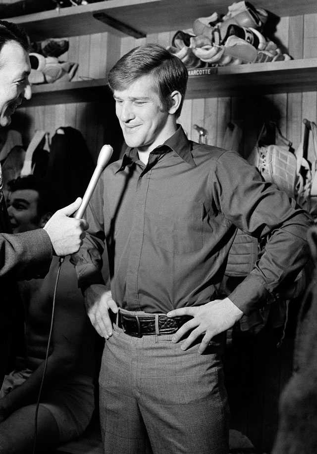 Bobby Orr smiles as he is interviewed in the dressing room after the Bruins defeated the Montreal Canadiens, 3-1, in their Stanley Cup playoff in Boston, April 8, 1971.