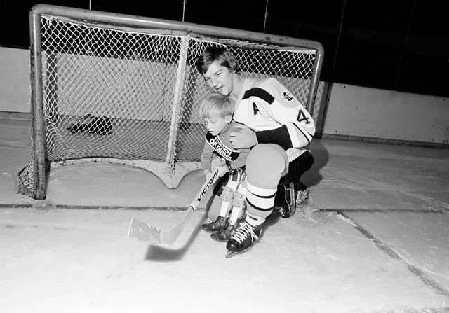Bobby Orr is shown with Scott Wade Hafen, 5, of Las Vegas, the March of Dimes National Poster Child, Jan. 8, 1974, in Boston. Scott was born with spina bifida.