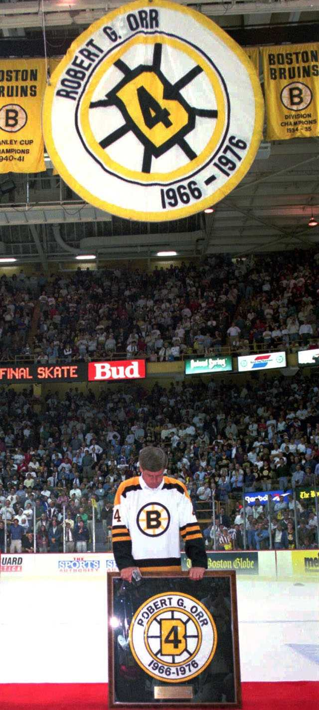 An emotional Bobby Orr bows his head acknowledging the applause of teammates and fans, during ceremonies at Boston Garden Tuesday night, Sept. 26, 1995 as Orr and other Bruins old timers stand by their retired numbers at a final farewell ceremony for the old Boston Garden.