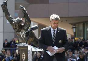 Bobby Orr addresses a crowd during an unveiling ceremony for a statue of Orr, left, in front of the TD Garden sports arena, in Boston, May 10, 2010. The statue depicts Orr in the defining moment when he scored in overtime in 1970 giving the Bruins victory over the St. Louis Blues to win the Stanley Cup.