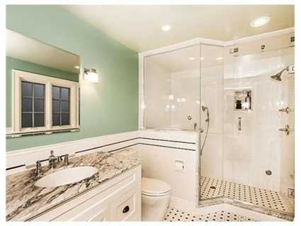 The second floor has private master suite with renovated bath with a steam shower.