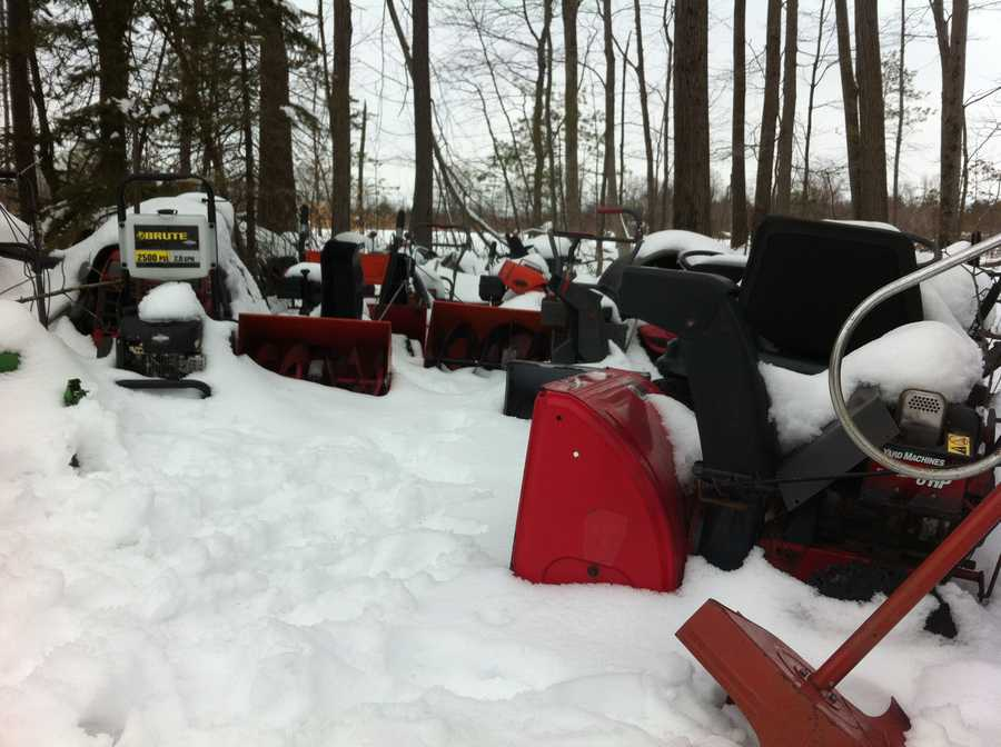 There are about a dozen lawnmowers and another dozen snowblowers.