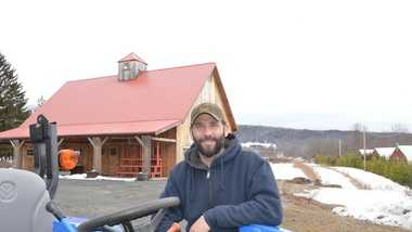 Gideon Porth, the new owner of Atlas Farms, stands in front of the farm's farm stand at 218 Greenfield Road in South Deerfield, where he plans on running the business this summer.