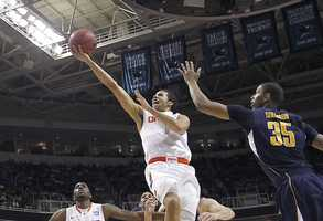 Syracuse University guard Michael Carter-Williams was in the middle of a NCAA basketball tournament Saturday against the University of California when his Hamilton home caught fire.