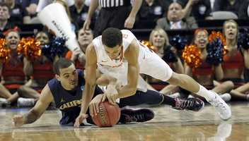 California guard Justin Cobbs (1) battles for a loose ball against Syracuse guard Michael Carter-Williams (1) during the first half of a third-round game in the NCAA college basketball tournament Saturday, March 23, 2013, in San Jose, Calif.
