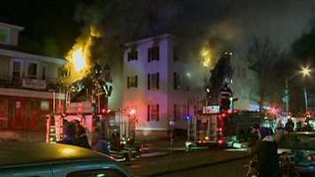 Firefighters battled a four-alarm fire that broke out in an apartment building in Lynn late Sunday night.