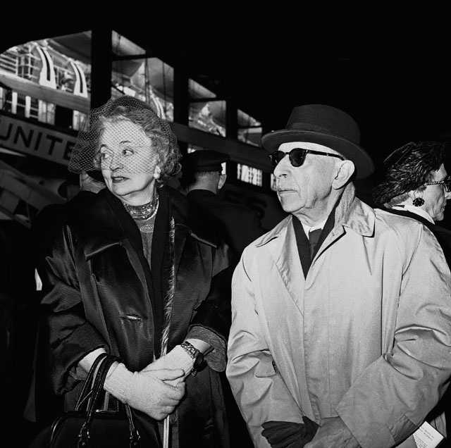 Igor Stravinsky, composer and orchestra conductor, with Mrs. Vera Stravinsky as they both arrive aboard the liner S.S. United States in New York City on Dec. 19, 1958.