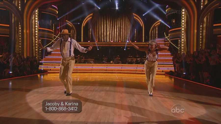 NFL Wide receiver Jacoby Jones and his professional partner Karina Smirnoff dance a jazz routine.