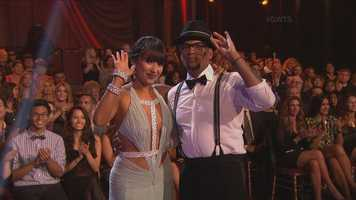Comedian & actor D. L. Hughley and his dance partner Cheryl Burke performed the quick step.