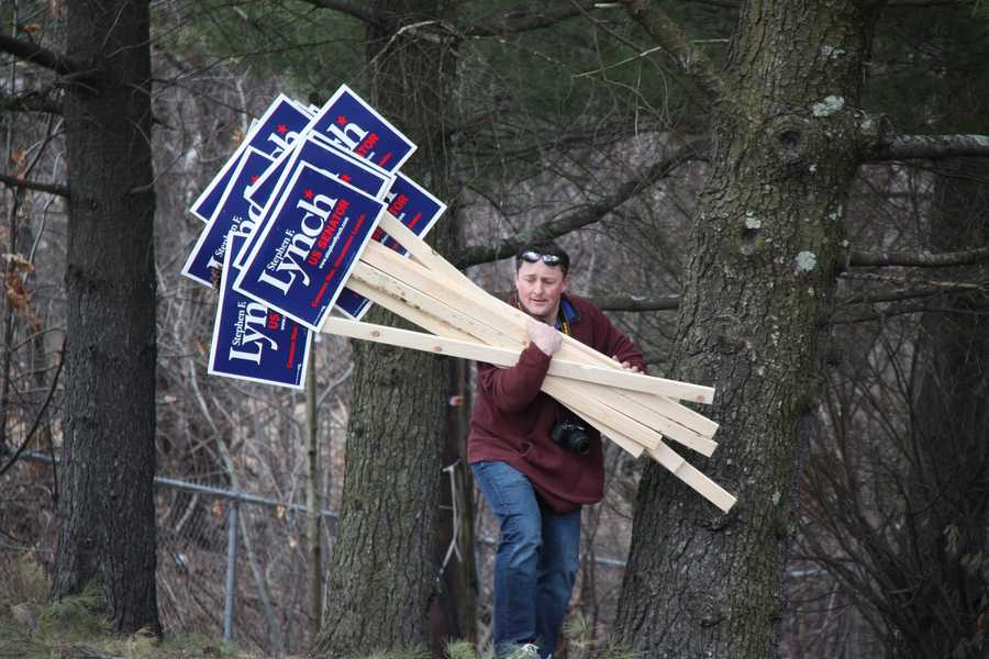 A Lynch supporter carries signs to give to others prior to the debate.