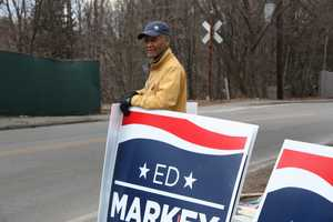 A Markey supporter awaits his candidate before the debate.