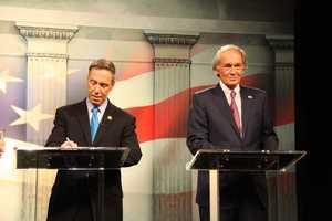Congressman Stephen Lynch and Ed Markey wait for their debate to begin.