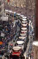 Members of the New England Patriots ride in Duck Boats down Tremont Street in Boston, Tuesday, Feb. 5, 2002, during a parade held to celebrate the team's Super Bowl win.