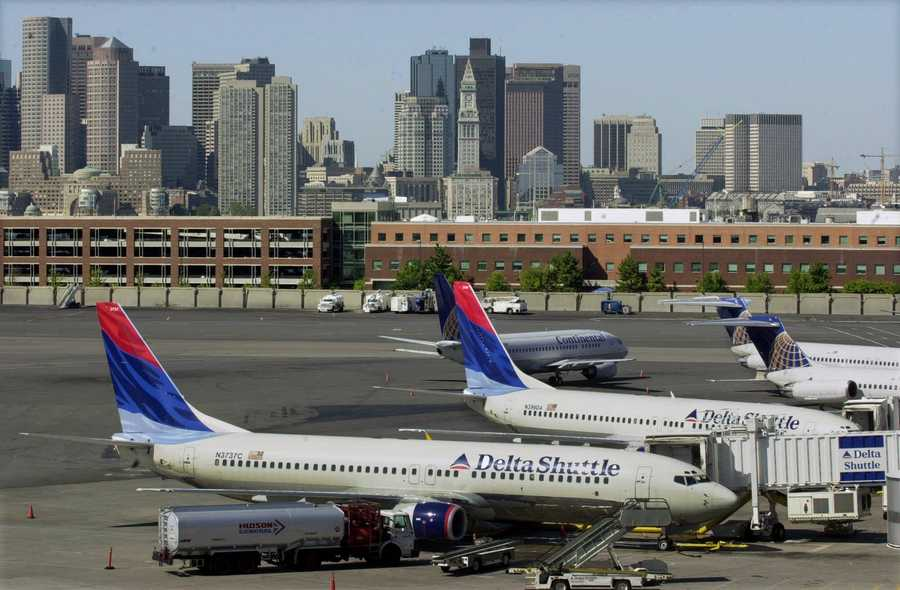 Planes sit idle at gates at Logan International Airport in Boston Tuesday, Sept. 11, 2001, as airports across the United States are shut down in the wake of the crashes into New York's World Trade Center.