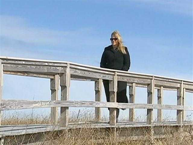 A long-time resident, Irene Davis says the dunes along Town Neck Beach are all that stand between rising waters and the historic district of Sandwich.