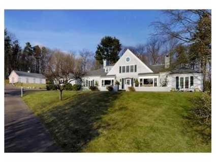 This elegant shingle style equestrian property is privately situated atop one of the highest points in Hamilton.